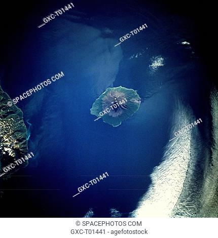 This low-oblique, southwest-looking photograph of Atlasova Island shows the classic radial drainage pattern seen in most stratovolcanoes