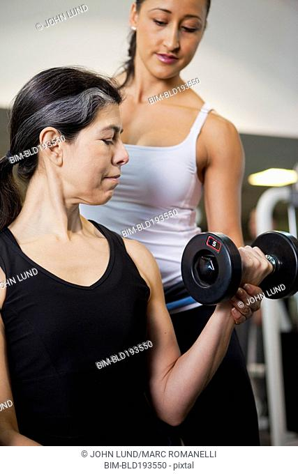 Hispanic woman lifting weights