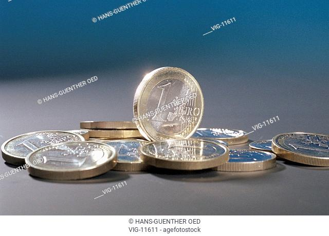 1 Euro coins, lying and standing ( originals ). - MUENCHEN, GERMANY, 22/10/1998