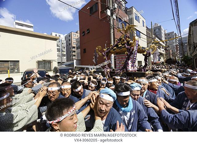 Participants carry a Mikoshi (portable shrine) during the Sanja Matsuri in Asakusa district on May 20, 2018, Tokyo, Japan