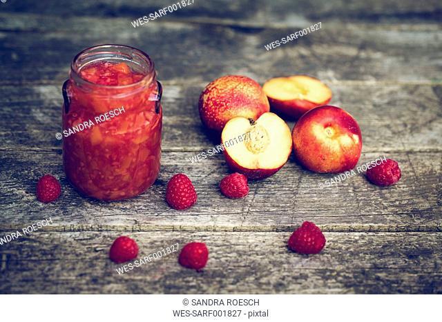 Strawberry nectarine jam in glass