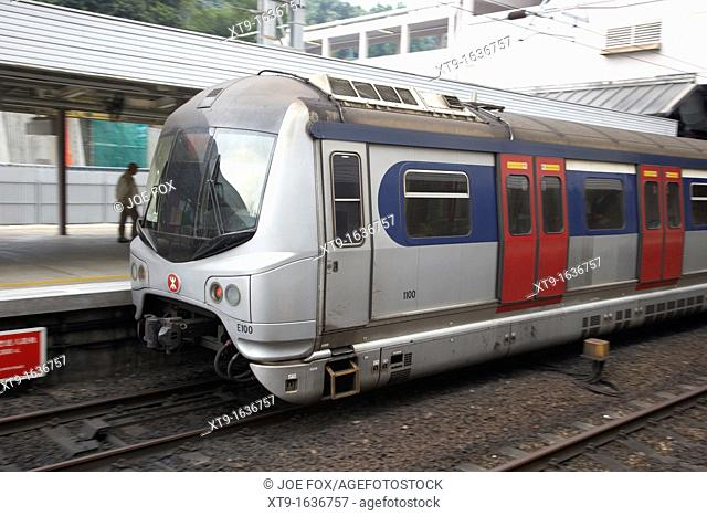 MTR MLR train speeds through sha tin station on the mtr overground line former kcr kowloon canton railway hong kong hksar china asia