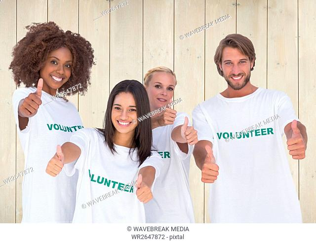 Group of volunteers showing thumbs up