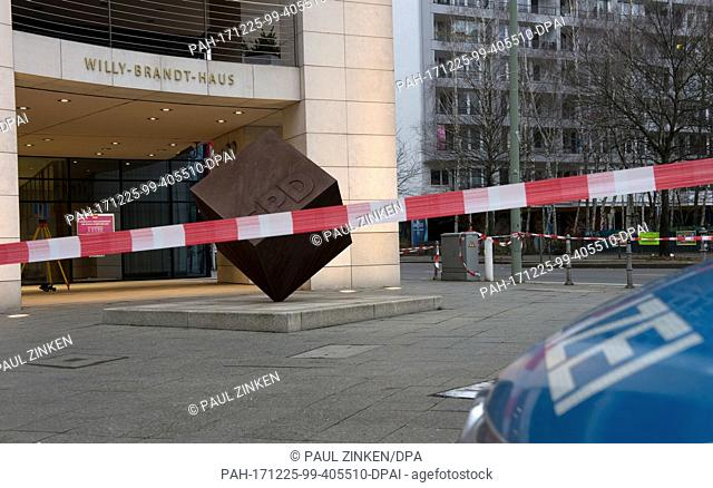 A police cordon blocks entry to the SPDparty headquarters in Berlin, Germany, 25 December 2017. Police say a driver deliberately rammed a car into the building...