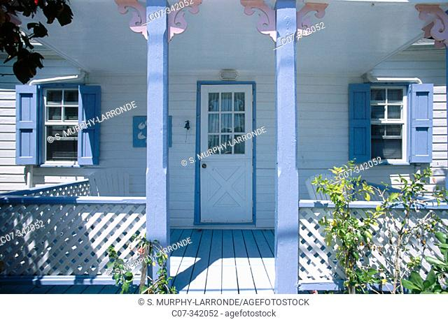 small clapboard house at the center of historic Hope Town, a popular tourist haven for sailors in the Bahamas