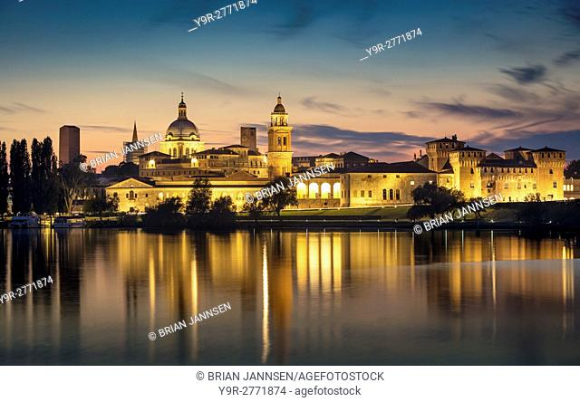 Twilight over Mantova skyline reflected in Lago Inferiore, Lombardy, Italy