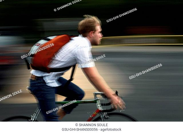 Blurred Teen Boy Riding Bicycle