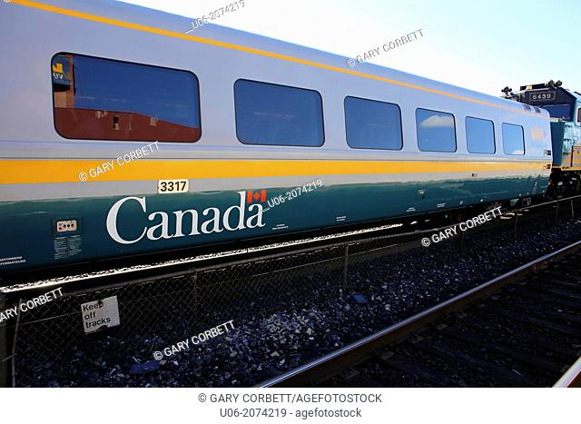 A Canadian VIA rail passenger train car with the Canada logo on it's side