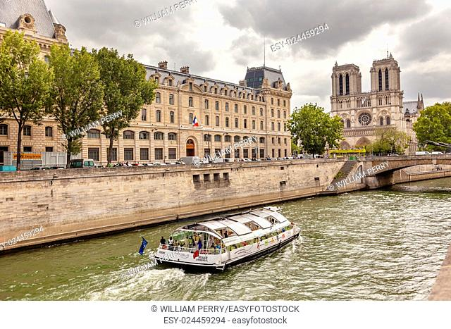 Tour Boat Seine River Notre Dame Spires Towers Bridge Overcast Skies Notre Dame Cathedral Paris France. Notre Dame was built between 1163 and 1250 AD