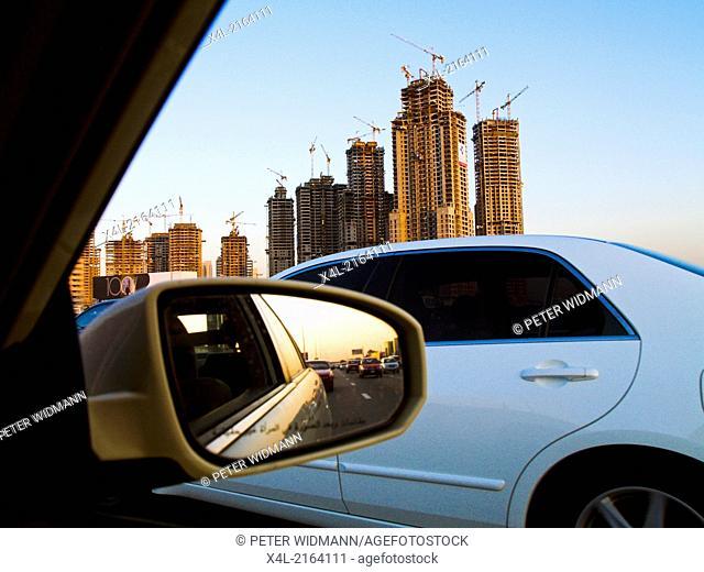 Dubai, construction site around Burj Dubai, limousine with darkened windows, rear view mirror, Sheik Zayed Road, United Arab Emirates