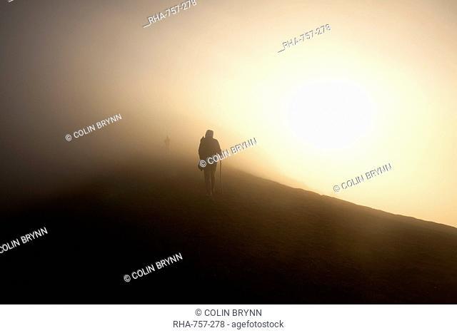 Woman walking on the summit of Volcan Acatenango, Guatemala, Central America