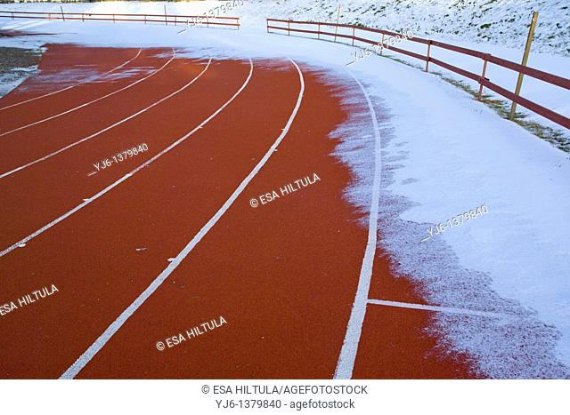 athletics lanes covered with snow