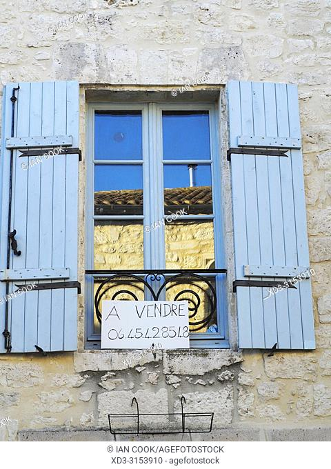 shuttered window with for sale sign, Issigeac, Dordogne Department, Nouvelle-Aquitaine, France