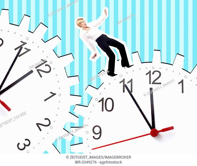 Young business woman between two clocks, composing