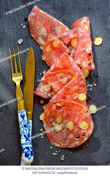 Italian salami with nuts on ardesia plate