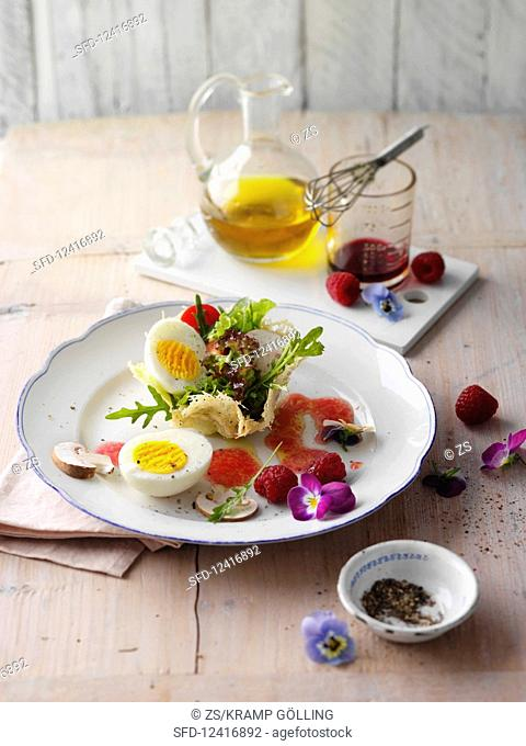 A boiled egg with a colourful salad in a parmesan nest