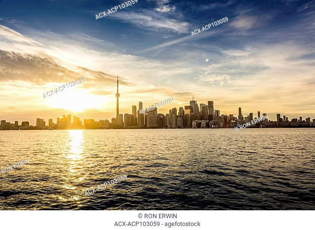 Sun setting behind the City of Toronto, Ontario, Canada as seen from Algonquin Island - one of the Toronto Islands