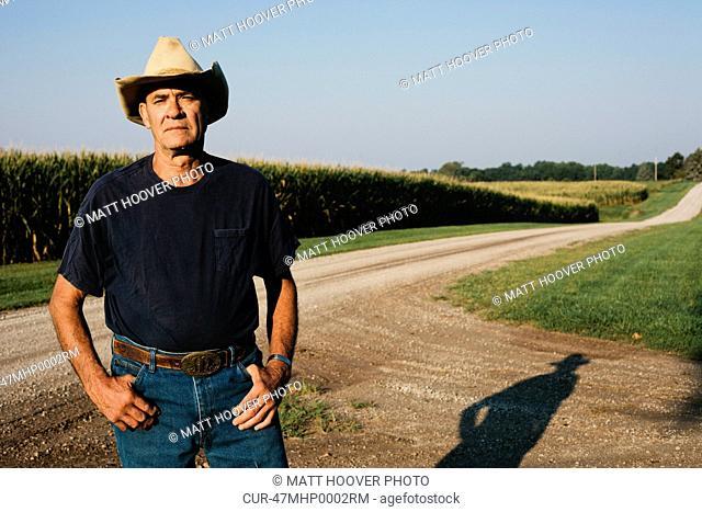 Farmer standing on dirt road