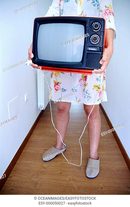 Woman holding red television