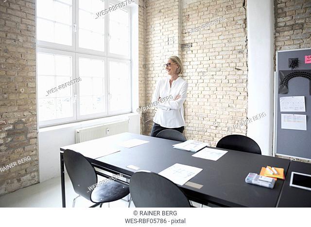 Mature businesswoman preparing for conference