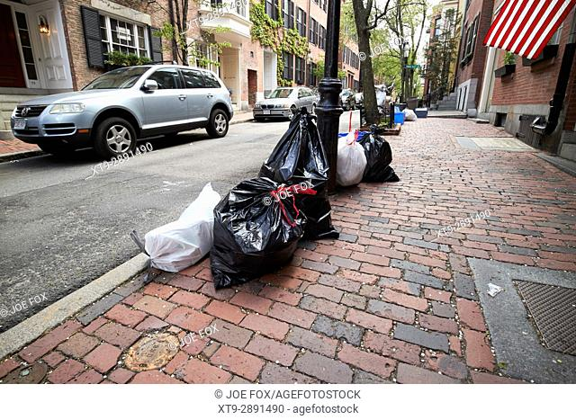 waste refuse left out for collection in historic beacon hill distric Boston USA