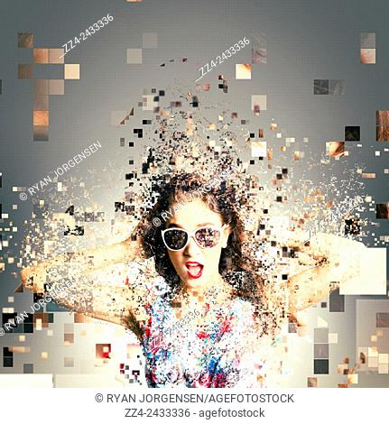 Creative fashion abstract photo of a modern age pin up girl shattering into electronic shards of digital bites and pieces