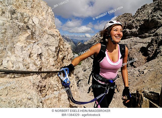 Climber, woman, on fixed rope route onto Paterno, Alta Pusteria, Sexten Dolomites, South Tyrol, Italy, Europe
