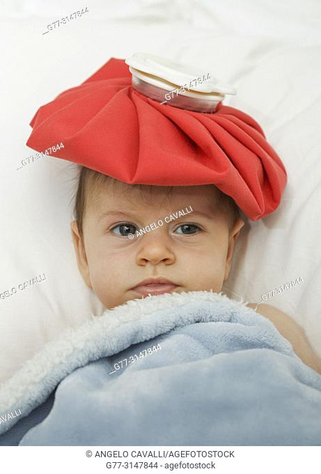 4 months old baby with ice pack on the head