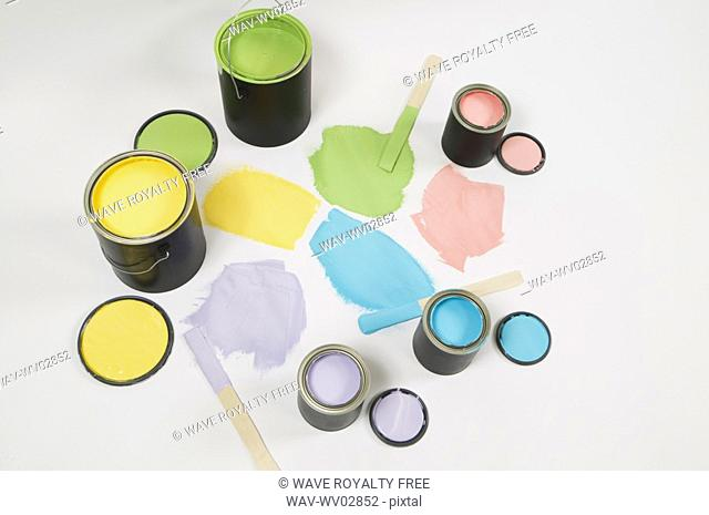 Open paint cans, lids, colour swatch and stir sticks, Canada, British Columbia