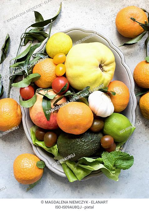 Overhead view of colourful fruit and vegetables in serving dish