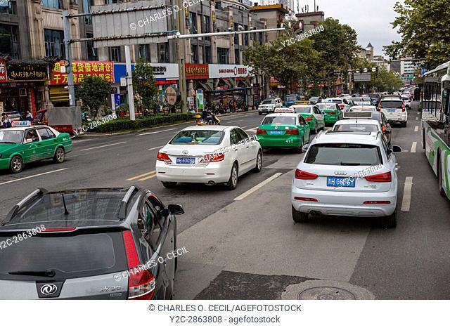 Kaili, Guizhou, China. Mid-day Traffic on a Downtown Street