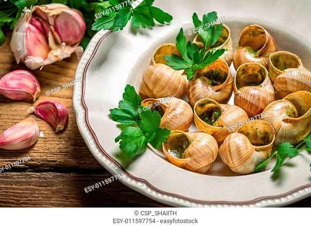 Snails baked in garlic butter and served with parsley