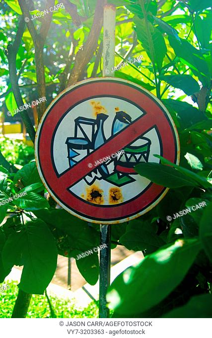 Don't Throw the Trash Away Sign nearby the beach of the Bali island, Indonesia. Bali is an Indonesian island and known as a tourist destination