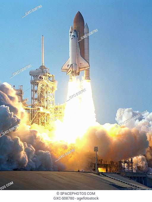 08/10/2001 --Space Shuttle Discovery clears the lightning rod on Launch Pad 39A as it soars into the blue sky on mission STS-105 to the International Space...