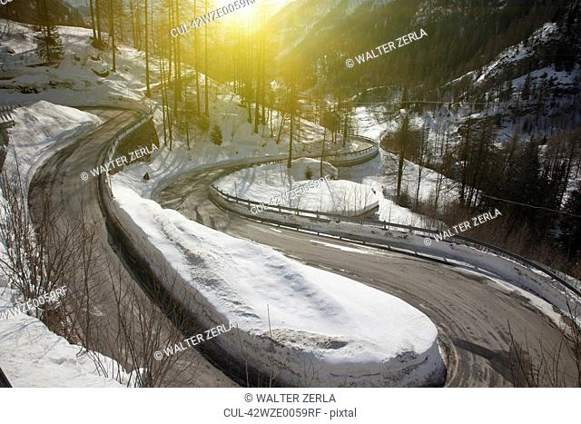 Winding road in snowy landscape