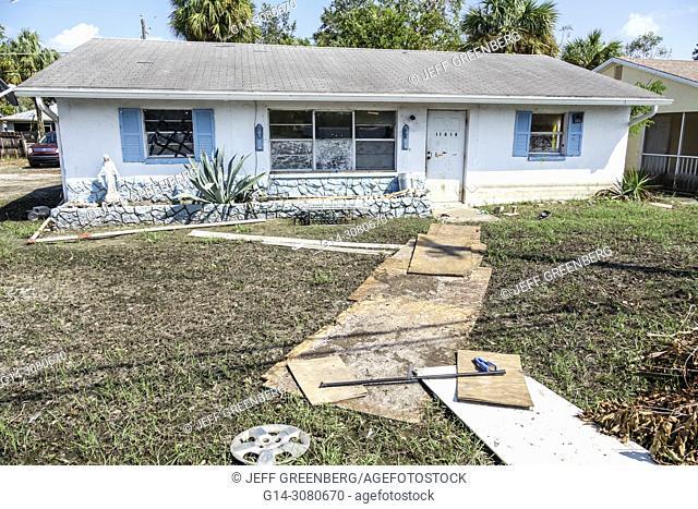 Florida, Bonita Springs, after Hurricane Irma damage destruction aftermath, , flooding, house, home, muddfy yard, plywood pathway, exterior
