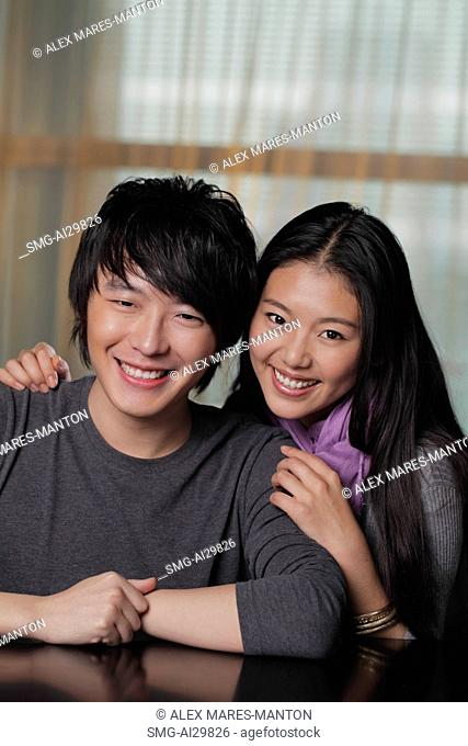 Head shot of young couple smiling together