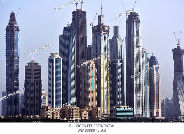 Panorama with skyscrapers, different levels of buildings and ambitious construction works, Dubai, United Arab Emirates