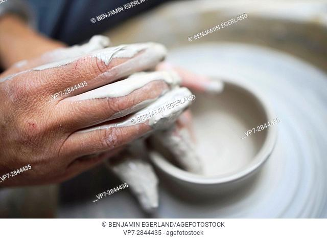 creative hands using clay to create pottery
