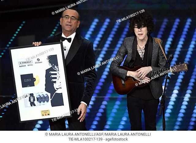 Carlo Conti with the triple platinum record of LP ( Laura Pergolizzi ) for the song Other people during the 67th Sanremo Music Festival, Sanremo