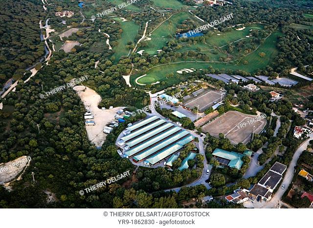 Horse riding club and facilities  A golf course in the back  Aerial view