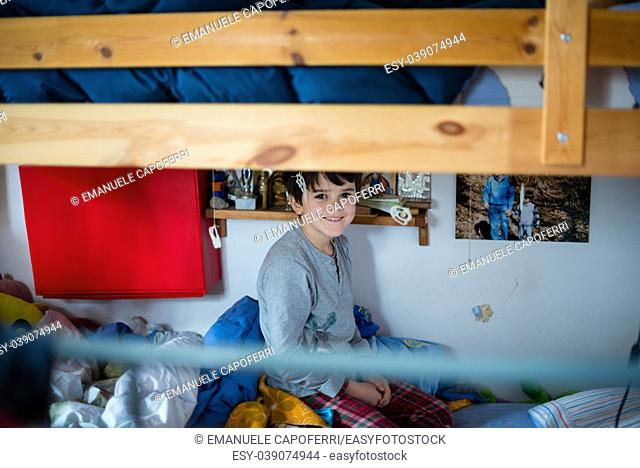 child portrait in the morning in his bunk bed