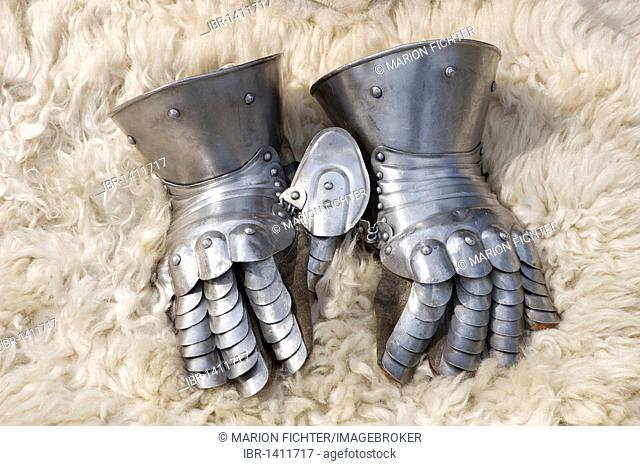 Metal gloves of a suit of armor on a sheepskin