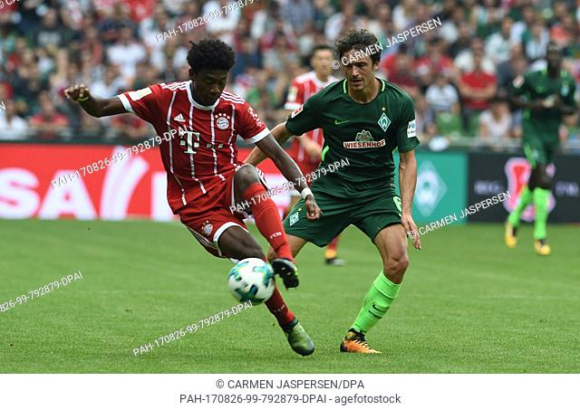Munich's David Alaba (L) and Bremen's Thomas Delaney vie for the ball during the Bundesliga soccer match between Werder Bremen and Bayern Munich at the...