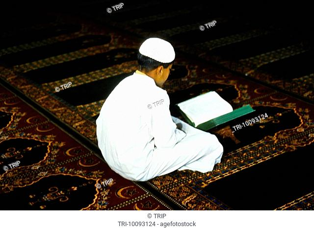 Saudi Arabia Teenager Reading The Quran