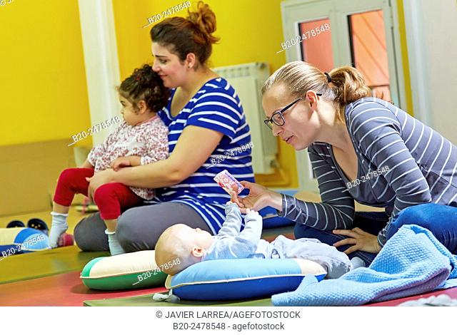 Mothers and babies at breastfeeding education program