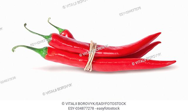 Three red chili peppers tied with a rope isolated on white background