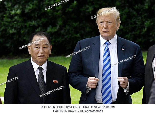 US President Donald Trump stands with Kim Yong Chol, former North Korean military intelligence chief and one of leader Kim Jong Un's closest aides