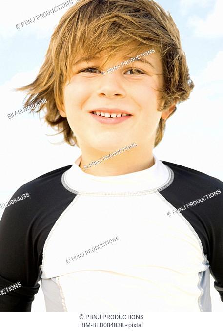 Wind blowing Caucasian boy's hair