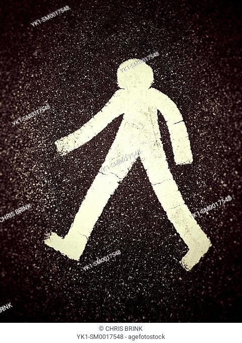 Pedestrian symbol on tarmac